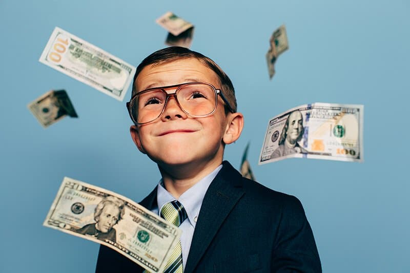 Young Boy Accountant Watches Money Fall from Sky