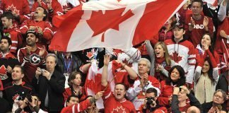 A large Canadian flag is waved during the Men's Gold Medal Hockey match between USA and Canada at the Canada Hockey Place during the XXI Winter Olympic Games in Vancouver, Canada